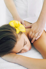 Woman receiving spa body massage