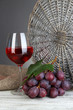 Ripe delicious grapes with glass of wine