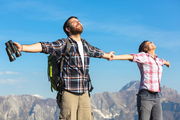 Young Couple at Top of the Mountain