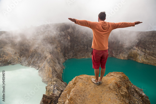 Man looking at Kelimutu lakes with changed colour
