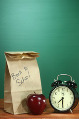 School Lunch, Apple and Clock on Desk at School