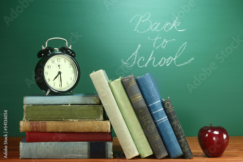 School Books, Apple and Clock on Desk at School