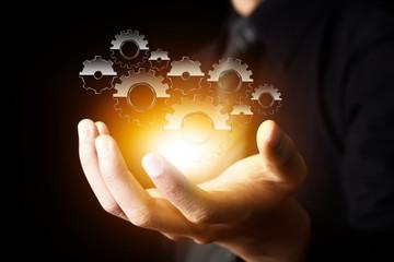 businessman hand show gear to success as concept