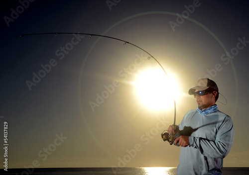 Man fishing during sunrise