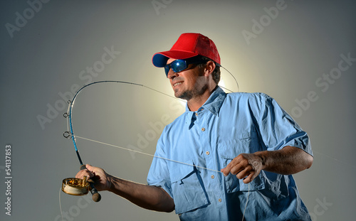 Fisherman and fishing rod