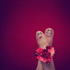 the happy finger couple in love with painted smiley and hold dia