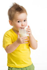 Little kid or child drinking dairy product from glass isolated o