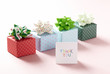 cute gift boxes against pink background