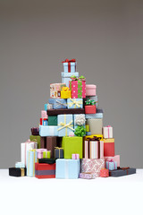 Wrapped presents stacked in the form of a pyramid with cute Gift