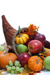 An overflowing cornucopia on a white background