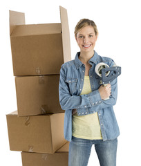 Woman With Adhesive Tape Standing By Stacked Cardboard Boxes