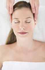 Beautiful Woman Receiving Head Massage At Health Spa