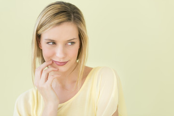 Woman Looking Away Against Green Background