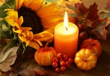 Arrangement of sunflower, candle and autumn decorations