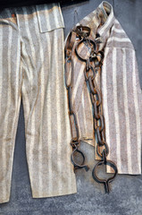 Chain, fetter and prisoner clothes in a prison