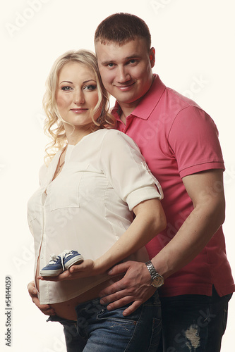 Happy young pregnant woman with her husband