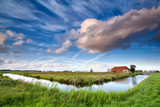 charming farmhouse and dramatic sky
