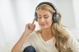 Beautiful Woman Listening To Music Through Headphones
