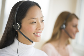 Happy Female Customer Service Representative Looking Away