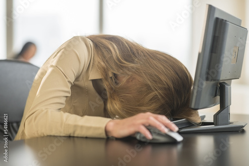 Tired Businesswoman With Head On Keyboard