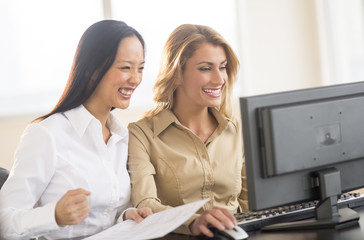 Successful Businesswomen Using Computer In Office