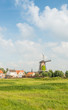 Dutch windmill at the edge of a small village