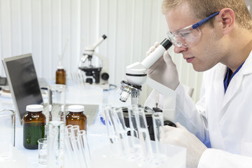 Male Scientist or Doctor Using Laboratory Microscope