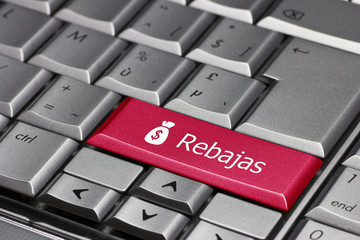 the word rebajas on a computer key