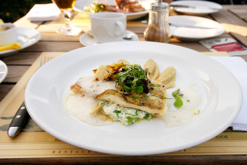 Walleye fillet with artichokes and molecular broth