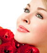 beautiful female face with red flowers