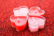 pink candles in form of heart