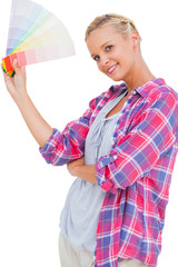 Young woman holding color charts and smiling at camera