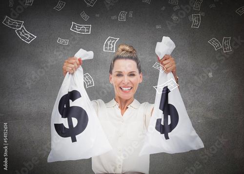 Businesswoman holding cash bags