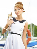 Fashionable woman with little chihuahua outdoor