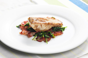tilapia fillet with warm spinach and bacon salad