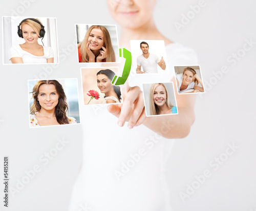 woman with virtual screen and contact icons