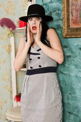 Frightened screaming retro model in the boudoir
