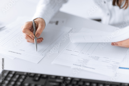 woman hand filling in blank paper or document