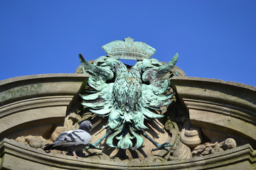 Coat of arms in the form a two-headed eagle