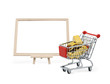 Gold bar in shopping cart with blank board
