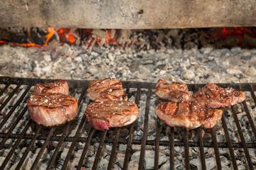 Sirloin steaks on grill
