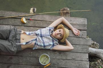 Beautifull girl lying on the pier