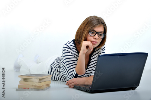 female learning next to computer