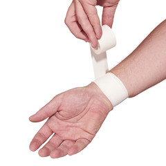 white medicine bandage on wrist.