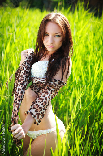 Attractive sensual woman in green cane field, on nature