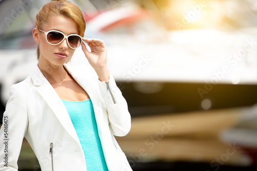 Outdoor portrait of a beautiful summer woman