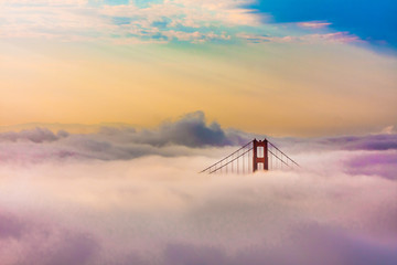 World Famous Golden Gate Bridge in thich Fog after Sunrise