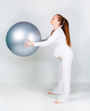 Pregnant woman with fit ball