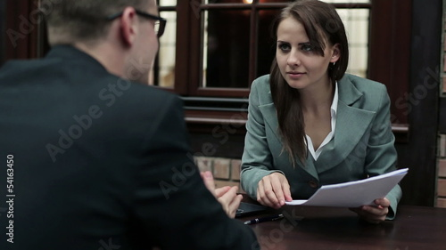 Job interview, businessman talking to businesswoman