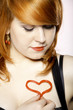 happy redhair girl with heart love symbol on chest